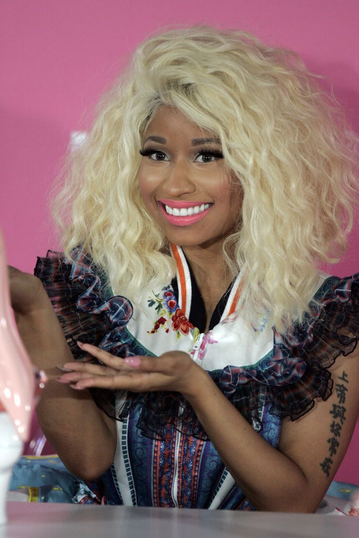 Nicki Minaj with frizzy blond hair launches her Pink Friday Perfume fragrance in Sydney, Australia.