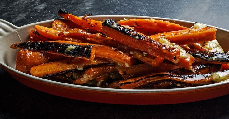 Crispy charred carrots are tossed with Brie and chile flakes for a cheesy and spicy side.