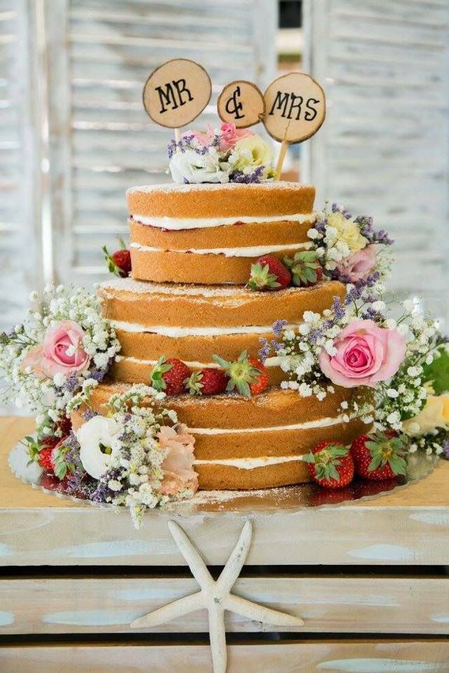 3 tier naked wedding cake with fresh flowers