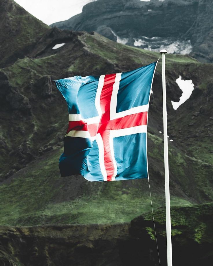 Iceland | The Icelandic Flag, its colours representing the ocean, the ice and the fire of the island's landscape.