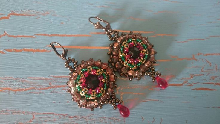 Bead embroidered earrings by Skipka