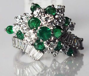 This ring is simply stunning as it sparkles with #diamonds and #emeralds. The ring is #platinum with one carat of Emerald in a prong setting and two carats round and #baguette diamonds.  Details:  Emeralds – natural Emeralds (11) round approx. 1.0ct  Diamonds -  natural Diamonds (15) round and 18 natural baguette 2.0 ct t.w. G in color SI in clarity, Platinum, Ring Size 5, 9.40 grams (weight), Face dimensions of the ring are 17 mm North to South. Price $3,450