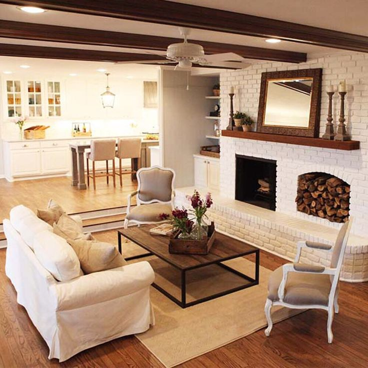 Exposed Ceiling Beams And White Brick With Natural Hardwood Light Airy Idea From HGTV Fixer Upper