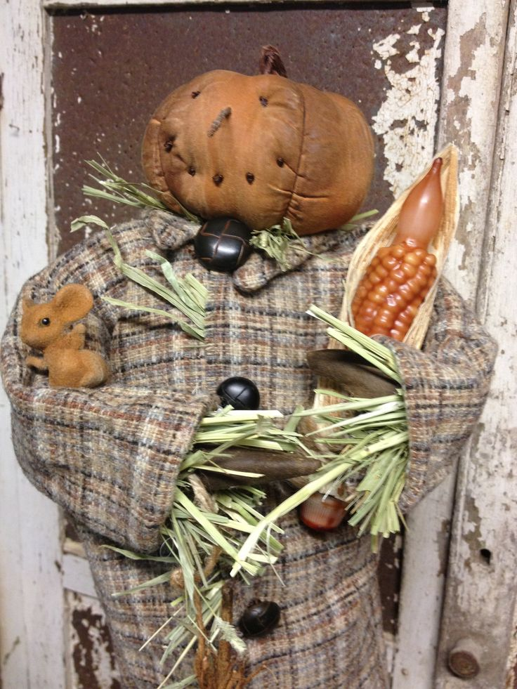 Primitive pumpkin scarecrow. Pattern adapted from an Antiquesannies pattern. Lovingly hand made by Olde Pear Primitives.