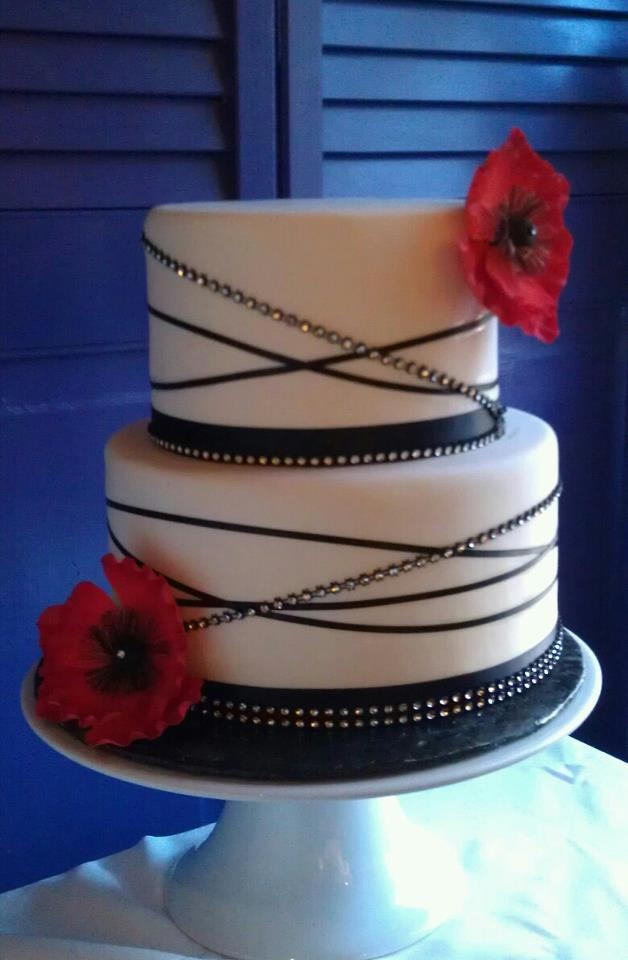 Black red and bling wedding cake created by Shannon Pilarski