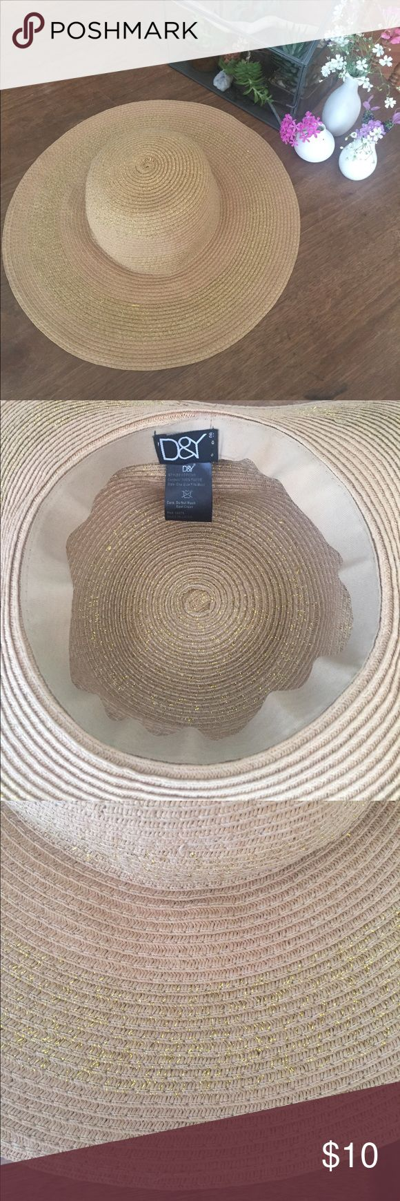 Wide brim straw and gold hat from Nordstrom Perfect for summer! Large stripes with subtle gold detailing. Floppy, not stiff brim. Comfortable and cute. One size fits most size. D&Y brand from Nordstrom. Nordstrom Accessories Hats