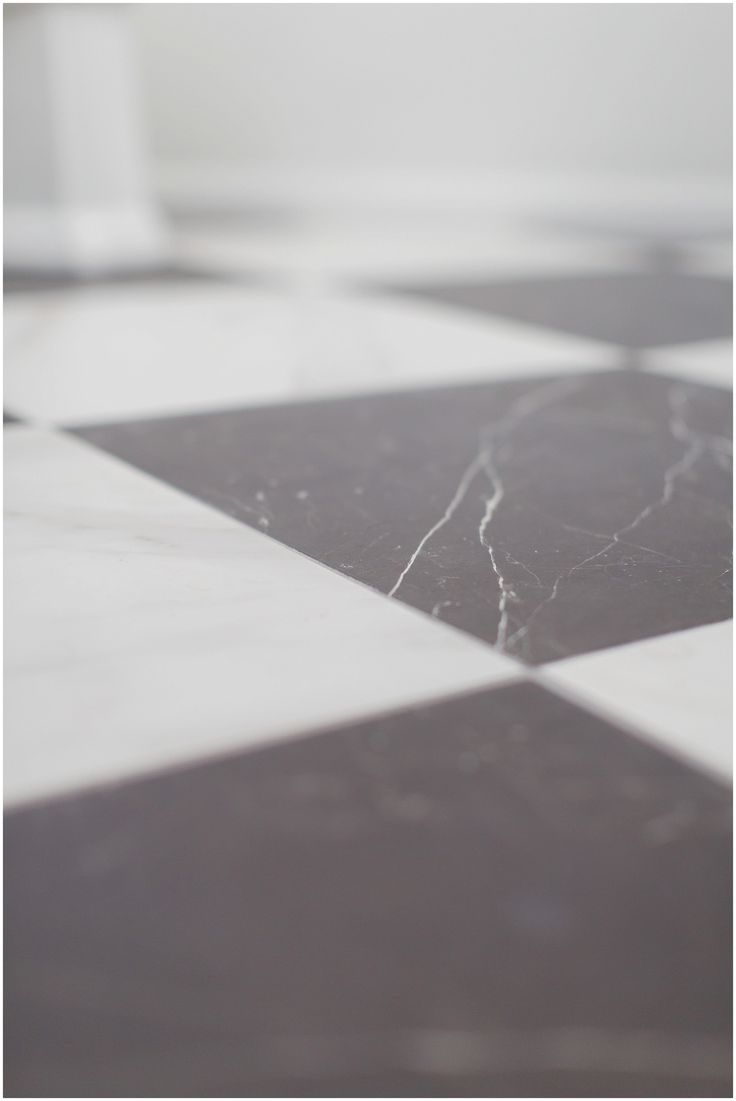 Black and White Porcelain Marble as Master Bathroom Floors laid on the diagonal