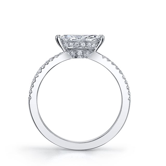 """The most delicate of Michael B.'s styles is the ROYAL Collection, designed with smaller center stones and petite fingers in mind.  Each ROYAL Engagement Ring features a mini """"flyer de lys"""" setting, custom made to the exact specifications of your center stone to ensure its safety and to ensure the gemstone is displayed in the most flattering manner possible. Supply your own center stone or purchase one from a Michael B. authorized retailer.  Each ROYAL Engagement Ring has a matching ROYAL…"""