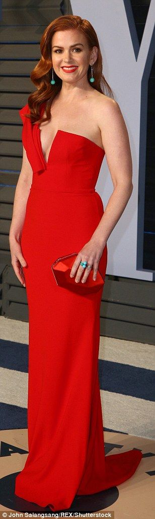 Knockout: Isla complemented her wavy red hair with a burnt-orange dress that fell off the ...