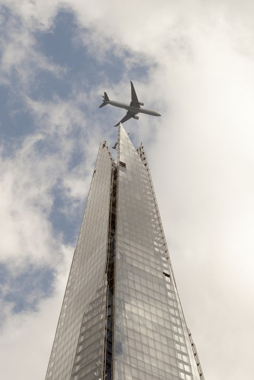 Jet Airways 777-300ERflying over The Shard,on approach to Heathrow