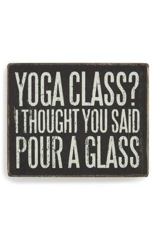 "Add a dash of quirky charm to your décor with a rustic box sign that states, ""Yoga class? I thought you said pour a glass.""4"" x 5"" x 1 3/4"".Freestanding. Can also be hung on the wall; mounting hardware not included.Wood/paper.By Primitives by Kathy; imported."