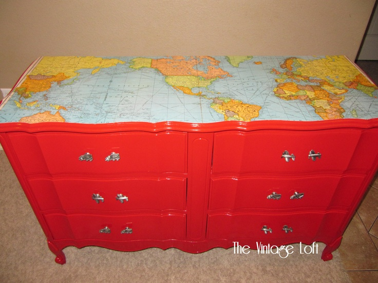 Travel/Map Dresser - I refinished this French Provincial dresser for my son's room and then repurposed an old map for the top of it. I glued the map down with Mod Podge and then sealed it with 3 coats of Minwax Polycrylic. I also added airplane and truck drawer pulls purchased from Hobby Lobby.