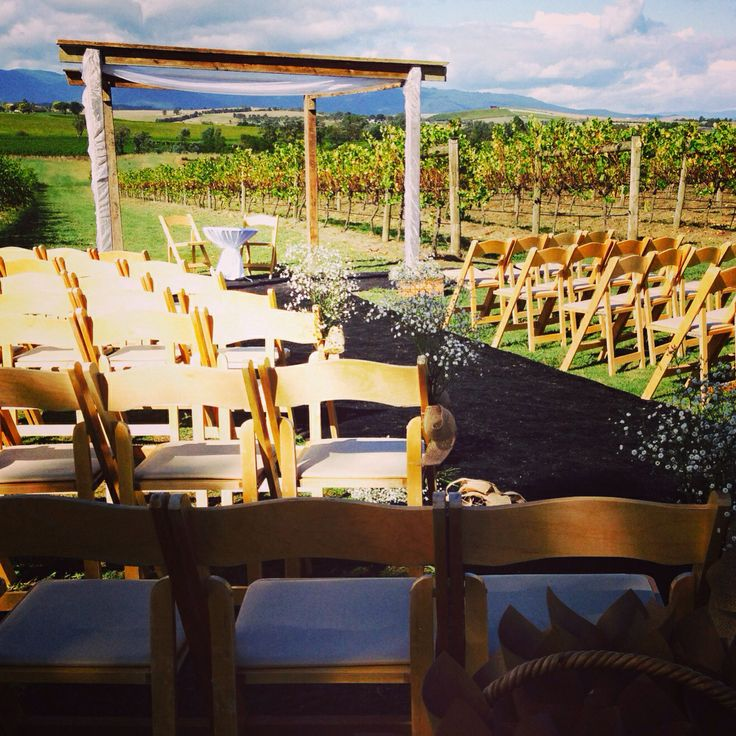 One of our last weddings before the season ends - an outdoor ceremony with a rustic vintage farm theme. Using our natural wood folding chairs, hay bales and a reclaimed wood arbour.