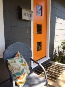 Midcentury Exterior Design with Orange Front Door