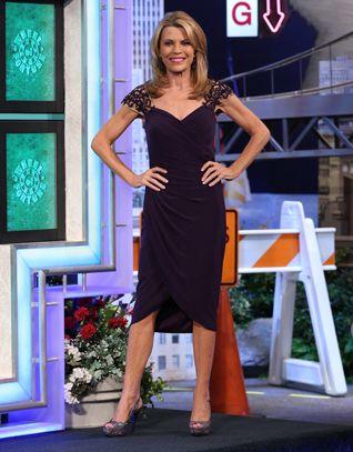 LA FEMME: Plum stretch mesh cocktail dress w/nude illusion shoulders trimmed in rhinestone lace, shirred bodice w/v-neckline, asymmetrical wrap skirt  | Vanna White's dresses | Wheel of Fortune