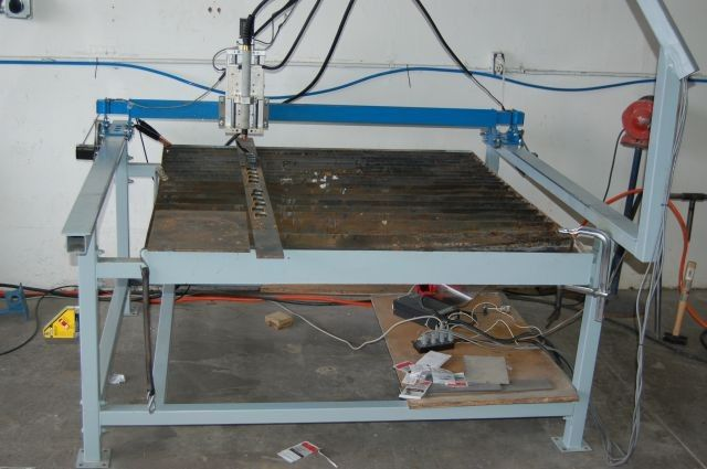 "CNC Plasma Table by r08ert209cali -- Homemade 4x4 CNC plasma table constructed from 2"" square tubing, flat steel stock, and a 4x8 sheet of 14-gauge sheet steel. http://www.homemadetools.net/homemade-cnc-plasma-table-3"