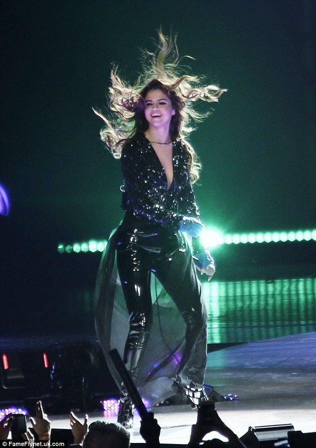 Working it: Selena Gomez was determined the must go on as she worked the stage at her tour date in Vancouver on Saturday night after being caught up in an Orlando Bloom flirty scandal