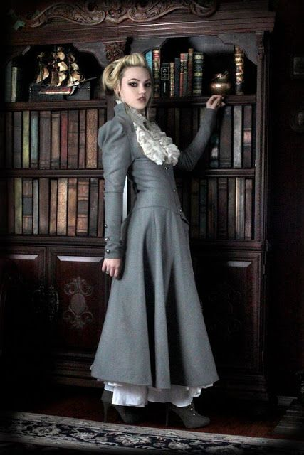 Gothic in Gray (steamgoth or gothic neo-victorian long gray coat with white ruffle blouse) - For costume tutorials, clothing guide, fashion inspiration photo gallery, calendar of Steampunk events, & more, visit SteampunkFashionGuide.com