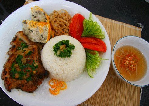One of most popular Vietnamese Food recipes is Broken Rice Saigon Style. When you come to Ho Chi Minh City (Saigon), you should try this dish at least once time. One Broken Rice Dish with many beautiful colors from grilled pork chop with multi-flavor to steamed pork with egg custard, pork skin, vegetable as tomato, cucumber …  Get this recipe at www.vietnamesefood.com.vn/vietnamese-recipes/vietnamese-food-recipes/recipe-vietnamese-broken-rice-saigon-style-com-tam-vietnam.html