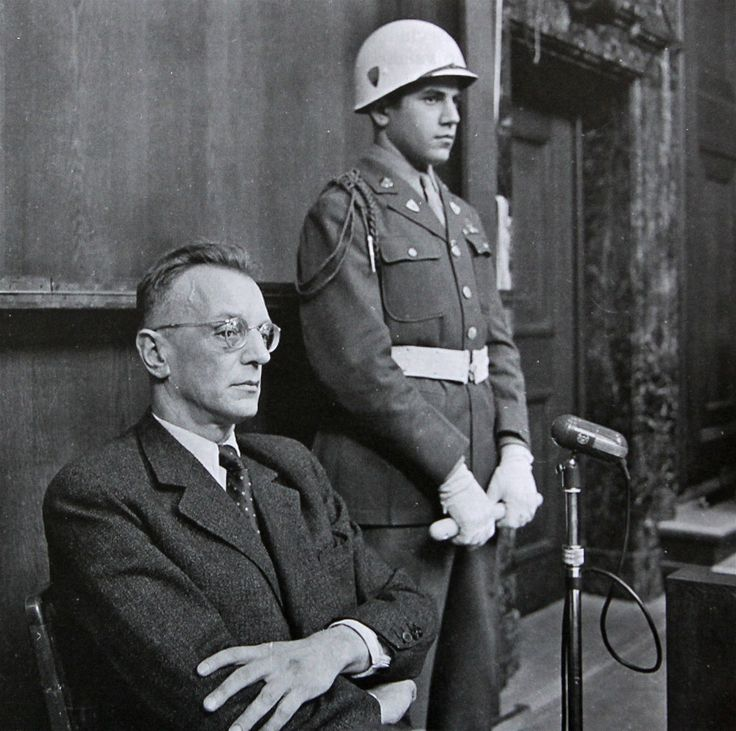 Arthur Seyss-Inquart at the Nuremberg Trials, with a guard (1946). He was a Nazi lawyer who held high offices in Austria and occupied Poland and was eventually made Reichskommissar of the Netherlands. After the war he was tried at Nuremberg alongside other Nazi leaders, was found guilty, and hanged on October 16, 1946.