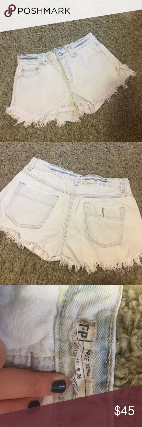 Free People white/ light blue denim cutoff shorts Free people shorts that basically look white (although in some light may have some undertones of light blue) fringe on the bottom and zip, button close. Full pockets in both front and back Free People Shorts Jean Shorts