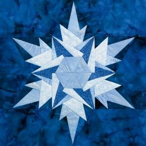Ice Crystal quilt block (foundation-pieced snowflake); I really like this design but I would continue alternating the fabrics in the center, too.  For some reason, this design reminds me of the movie, Frozen.