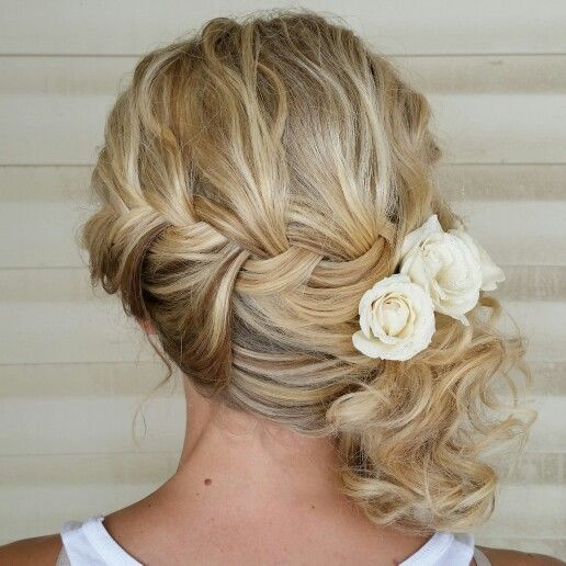 Bridal hair. Updo. Low side upstyle. Braid. Flowers.