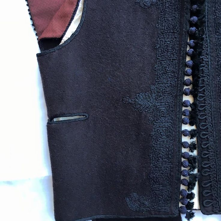 Handmade traditional man jacket from Avlonas Attica. It is the main garment of fustanella traditional costume. REPRODUCTION OF THE LOCAL TRADITIONAL COSTUMES MADE FROM THE EMBROIDERY GROUP OF OUR ASSOCIATION. All rights reserved