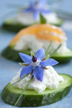 borage, Edible flower.   Cucumber canapés with goat cheese, chives and borage blossoms
