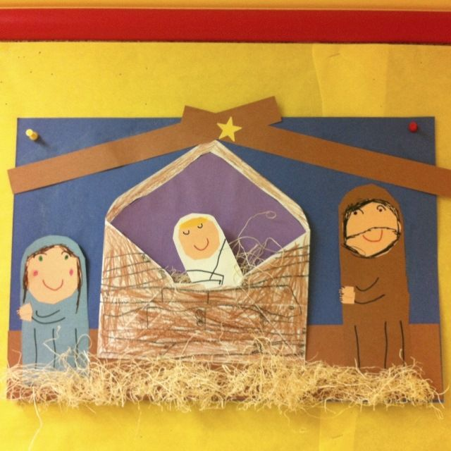 Cute nativity scene with an envelope for the manger. Christmas craft.