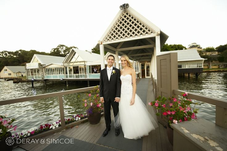 Bride and groom on the jetty over the Swan River. Wedding reception styling, ideas and inspiration.  Reception Venue: Mosman's Restaurant  Photography by DeRay & Simcoe