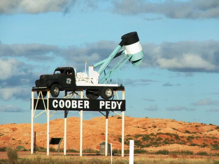 Coober Pedy, Australia. It's a town in the outback of Australia made for opal mining. The best part is.... IT'S UNDERGROUND! Wanna go here!