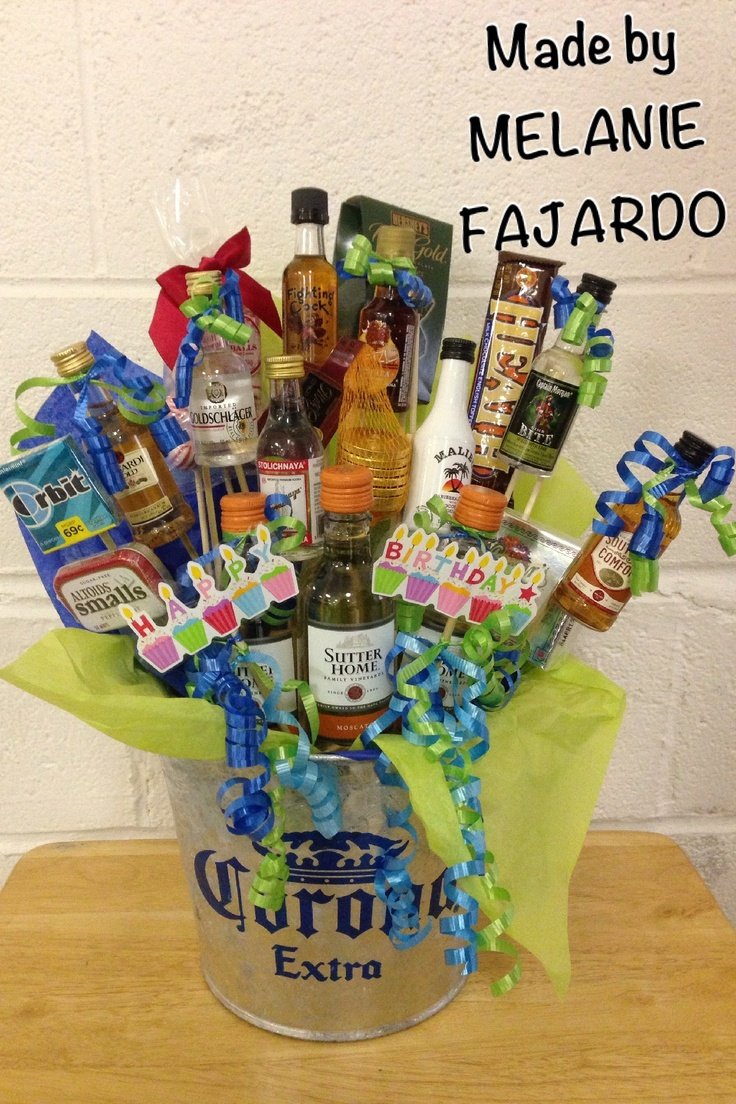 Liquor gift basket. Attach Mini Bottles to wooden skewers by using clear packaging tape. Use floral foam in bottom of bucket.