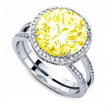 Canary Yellow Accented Engagement Ring - This Canary Yellow Accented Engagement Ring has a striking design with a split-shank & features a 2.67ct very well cut Canary Yellow center stone & is set with over 200 brilliant round side stones. This ring is 4.67 carats in total weight. The shank is 14k White Gold & all of the stones are 100% natural & heat-treated. #unusualengagementrings