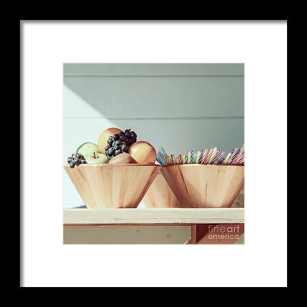 Fruit Bowl And Colorful Straws On Table Framed Print