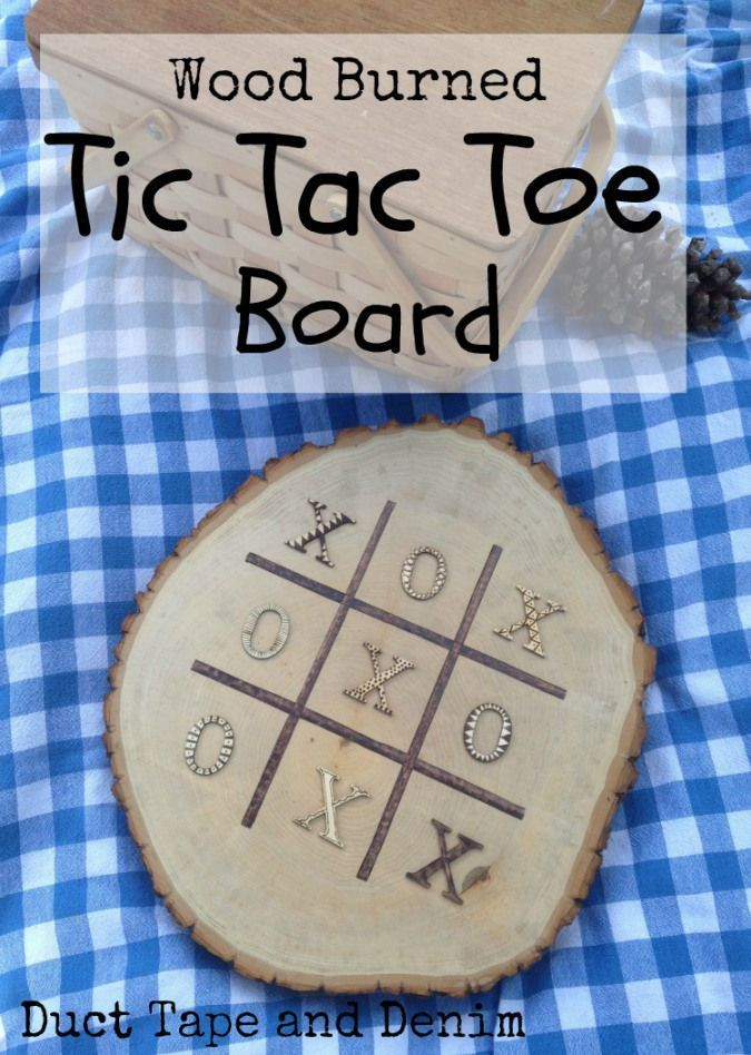 Wood burned tic tac toe board with Walnut Hollow rustic wood round.  A fun summer game board DIY idea.  More crafts and DIY ideas on DuctTapeAndDenim.com