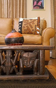 Tribal living room, I especially think the table would enhance a man's living space