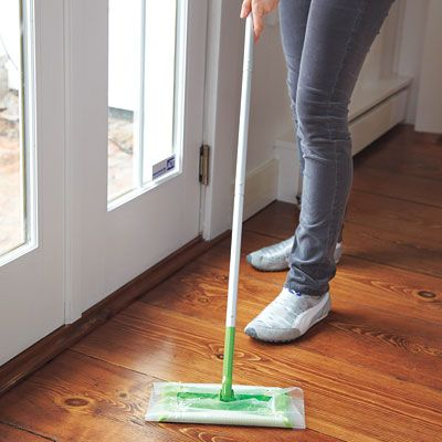To catch dirt in high-traffic areas, cut a piece of wax paper the size of a cleaning cloth and attach it to a wet/dry mop (like a Swiffer). | Photo: Wendell T. Webber | thisoldhouse.com
