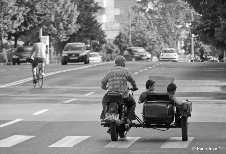 Grandpa with tweens on a motorcycle.