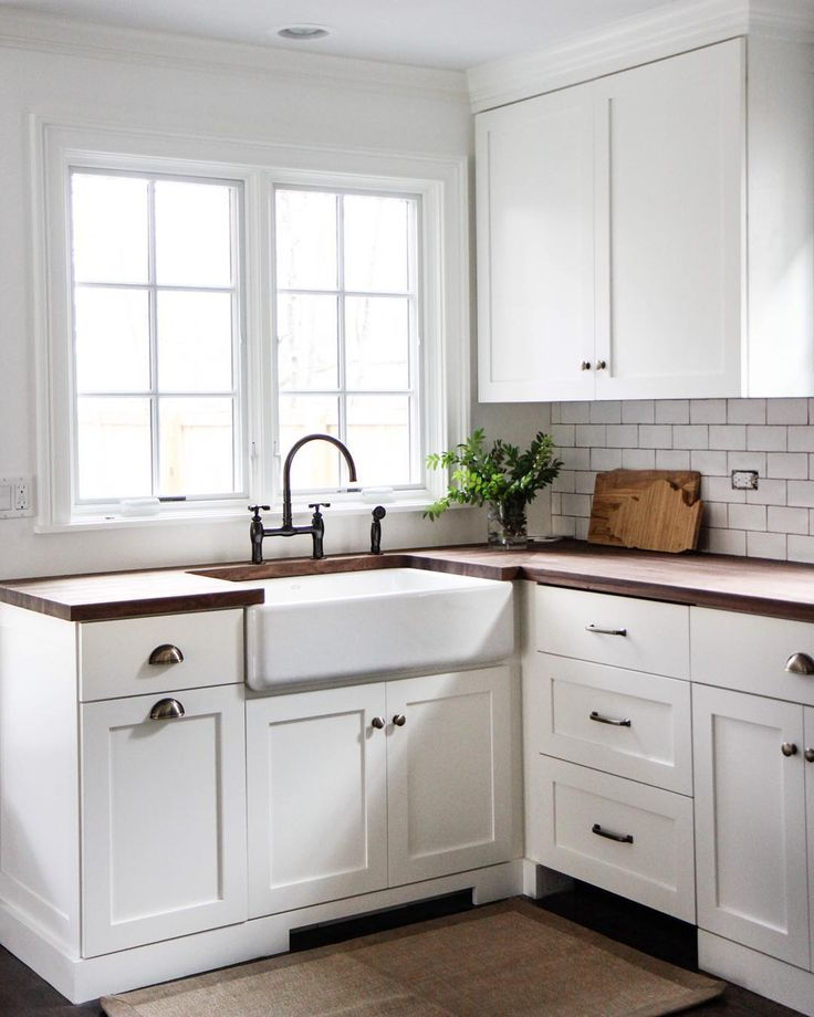 KITCHEN: Butcher block counters, white subway tile, farmhouse sink, hardware