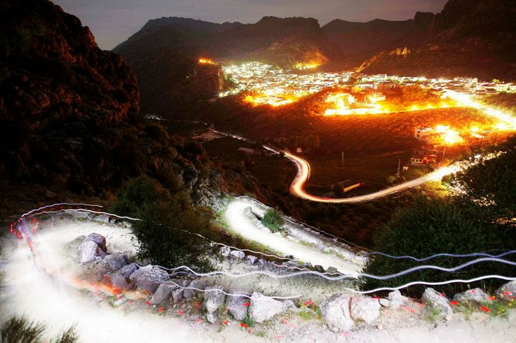 Trails of headlamps are seen in the night as runners make their way to the finish line during the XVII 101km competition on a mountain on the outskirts of Montejaque, near Ronda, southern Spain. (REUTERS/Jon Nazca)