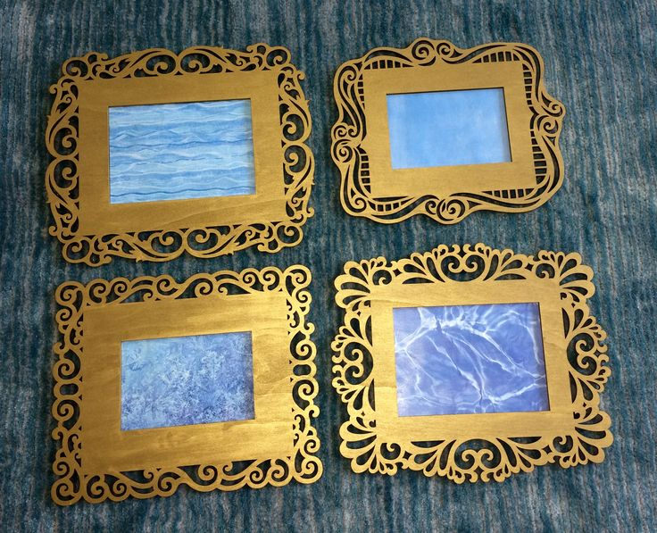 Laser cut wood frames with gold acrylic paint, complementary crafting papers with a coat of satin mod podge. Paper is just taped to the back of the frame in case I want to replace with something else in the future.