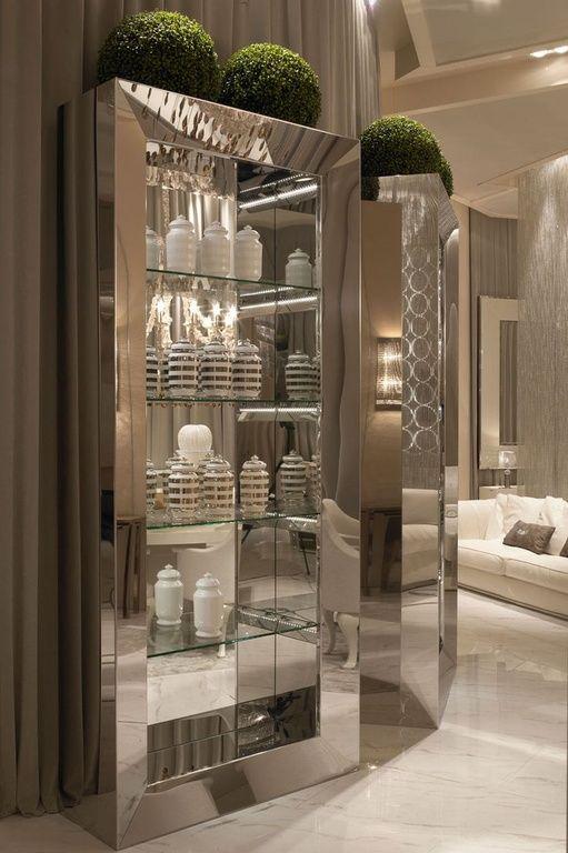 Art Deco Living Room with Bellini Modern Living Vera Curio Cabinet, Built-in bookshelf, simple marble floors, Exposed beam