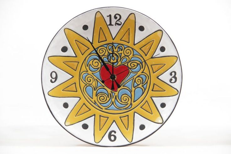 "Wall clock ""Presentosa"". Wall clock of italian ceramic, made and painted by hand with encrusted enamel. The decor represents the ""Presentosa"", the Abruzzese jewel par excellence, true masterpiece of the 18th century goldsmith's art."