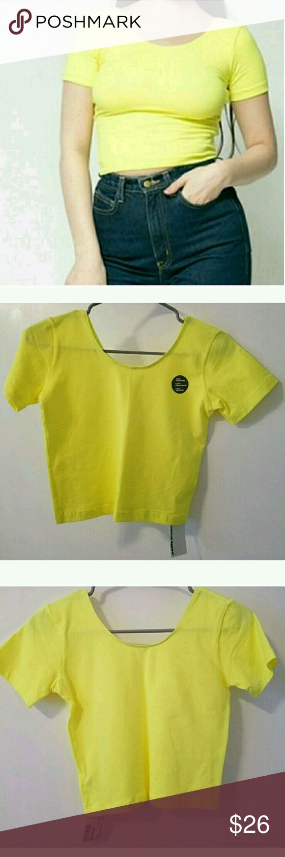 Neon Yellow Crop Top Neon Yellow Crop Top. Perfect everyday Top with Jeans, Shorts, Skirts. In perfect condition. Made in USA. American Apparel Tops Crop Tops