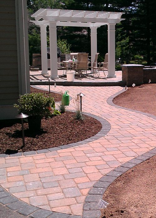 paver walkway leading to patio with pergola