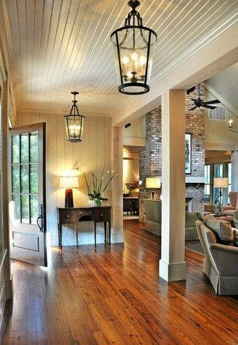 lanterns, planked walls and ceiling, entry door, fireplace, creams and wood
