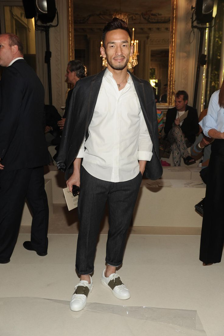 Hidetoshi Nakata wearing a Valentino suit and shirt from the Fall/Winter 15/16 collection and a pair of Valentino Garavani Open sneakers from the Spring/ Summer 2015 collection to attend the Valentino Men's Show on June 24th 2015.