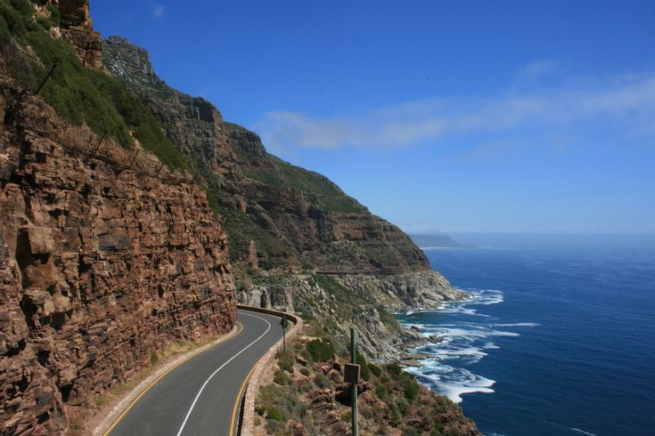 """Chapman's Peak Drive winds it way between Noordhoek and Hout Bay on the Atlantic Coast of South Africa. The 9km route, with its 114 curves, skirts the rocky coastline of Chapman's Peak (593m). The drive is affectionately known as """"Chappies"""" and offers stunning 180° views with many areas along the route where you can stop and take in the exquisite scenery."""