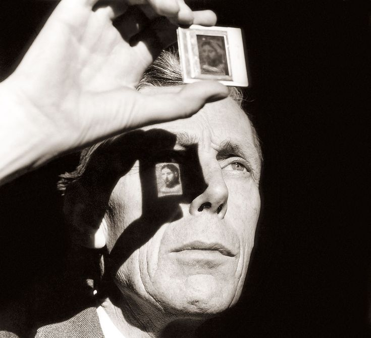 Anthony Blunt, by Lord Snowdon 1963 Anthony Blunt, Keeper of the Queen's pictures and Director of the Courtald Institute at the time of this photograph, 1963, seen here examining a transparency of a painting by Picasso.